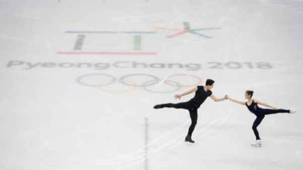 Figure skaters Kim Ju-Sik (L) and Ryom Tae-Ok of North Korea attend a practice session at the Gangneung Ice Arena in Gangneung prior to the Pyeongchang 2018 Winter Olympic Games on February 4, 2018.