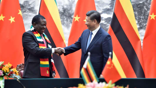 Zimbabwe's President Emmerson Mnangagwa (L) shakes hands with Chinese President Xi Jinping at the Great Hall of the People in Beijing, China, on April 3, 2018.