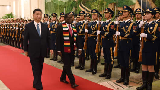 Zimbabwe's President Emmerson Mnangagwa (C) with Chinese President Xi Jinping (L) during a welcome ceremony at the Great Hall of the People in Beijing, China, on April 3, 2018.