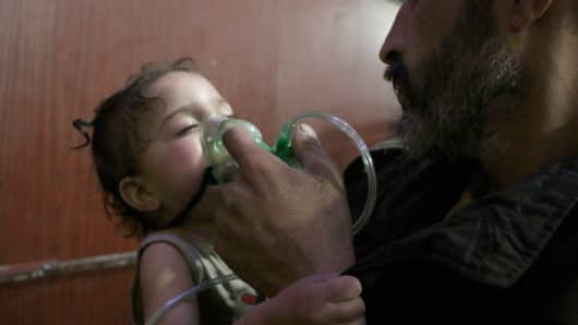 An affected Syrian kid receives medical treatment after Assad regime forces allegedly conducted poisonous gas attack to Duma town of Eastern Ghouta in Damascus, Syria on April 08, 2018.