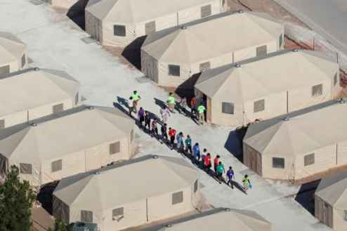 """Migrant children, many of whom have been separated from their parents under the """"zero tolerance"""" policy by the Trump administration, are being housed in tents next to the Mexican border in Tornillo, Texas, U.S. June 18, 2018."""