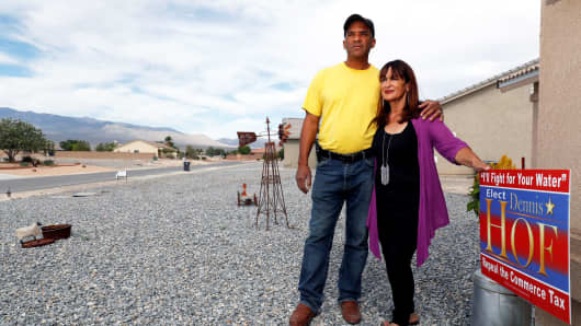 Dennis Hof supporters Victor Fuentes, pastor of the Ministerio Roca Solida church, and his wife Annette pose outside their home in Pahrump, Nevada, June 15, 2018.
