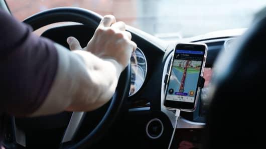 Uber driver uses GPS navigation.