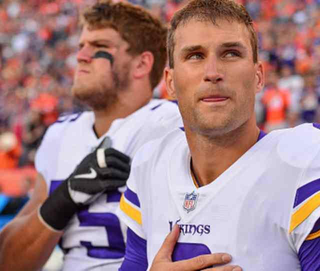 Quarterback Kirk Cousins Of The Minnesota Vikings Stands On The Sideline With Teammates During The Singing