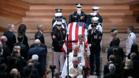 John McCain s daughter Meghan blasts  cheap rhetoric  of politics The casket is pictured leaving the memorial service of U S  Senator John  McCain  R