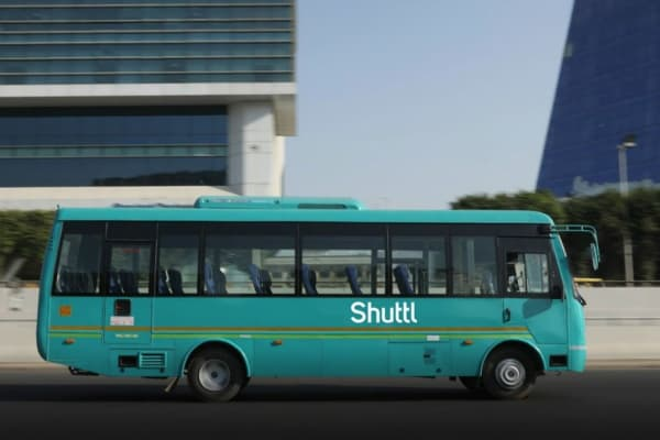 A promotional image of a Shuttl bus in India
