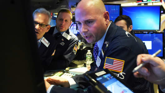 Traders work on the floor of the New York Stock Exchange, December 21, 2018.