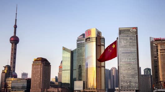SHANGHAI, CHINA - FEBRUARY 23: The Chinese flag floats before the skyscrapers of multinational corporations on February 23, 2018 in Shanghai, China.