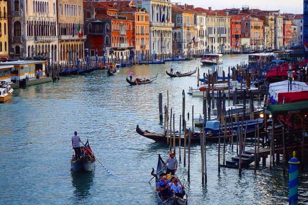 Gondoliers on the canals of Venice.