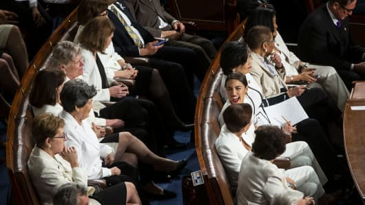 Deputy Alexandria Ocasio-Cortez, a Democrat from New York, smiles as US President Donald Trump, not pictured, an address from the state of the Union indicates a joint session of Congress in the US Capitol in Washington, DC, USA, on Tuesday, February 5, 2019.