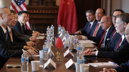 Secretary of Commerce Wilbur Ross, US Trade Representative Robert Lighthizer, Treasury Secretary Steven Mnuchin, Director of National Economic Council Larry Kudlow and other Trump administration officials sit with Chinese Vice Premier Liu He (L), Governor of the Central Bank, Yi Gang 2. L) and other Chinese deputy ministers and high-ranking officials for negotiations in the Diplomatic Room of the Eisenhower Executive Office Building on January 30, 2019 in Washington, DC. The top sales representatives begin two days of personal trade talks to end a months-long trade war between the world's two largest economies. (Photo by Chip Somodevilla / Getty Images)