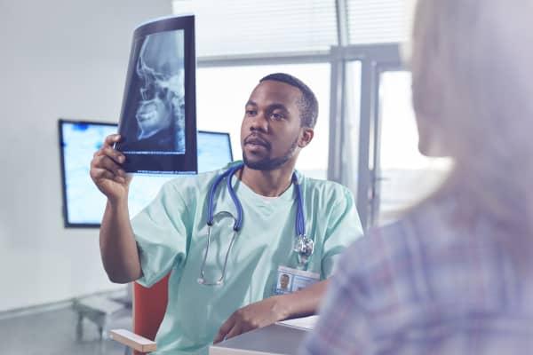 Male surgeon examining skull x-ray in hospital