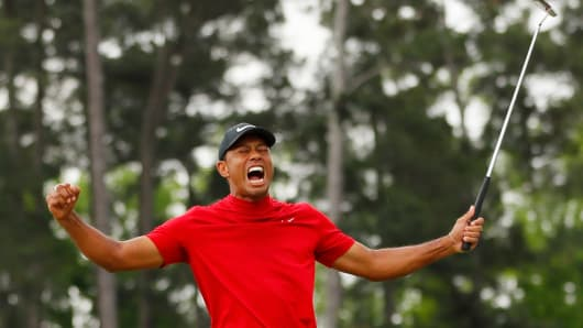 Tiger Woods of the United States celebrates after sinking his putt on the 18th green to win during the final round of the Masters at Augusta National Golf Club on April 14, 2019 in Augusta, Georgia.