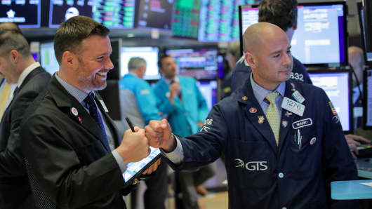 Traders work the floor at the NYSE in New York.