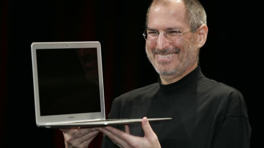 Apple CEO Steve Jobs smiles as he shows off the new Macbook Air an ultra portable laptop during his keynote speech at the MacWorld Conference & Expo in San Francisco, California, 15 January 2008.