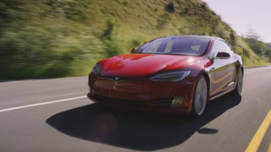 Tesla just reported second-quarter delivery numbers — Here's what 3 experts say to watch now