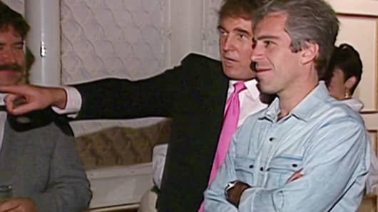A video still from the NBC archive showing Donald Trump talking with Jeffrey Epstein at a party in Mar-A-Lago from 1992.