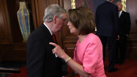 Mitch McConnell speaks with Nancy Pelosi following an on Dec.8, 2016 in Washington, DC.