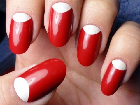 Red nails with white half moons