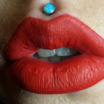 Medusa piercing and red lips