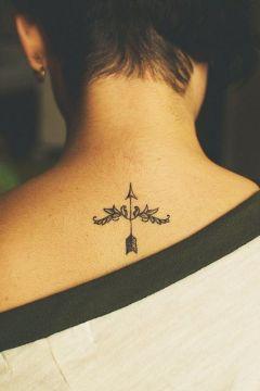 Decorated arrow tattoo