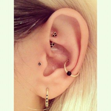 Gold and black snug piercing