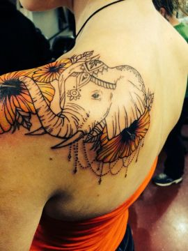 Feminine Elephant Tattoo with Flowers