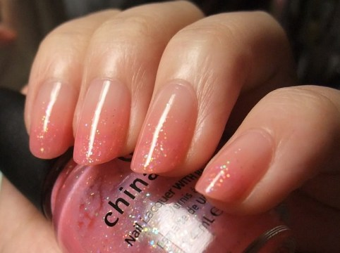 Peach to clear gradient nails.