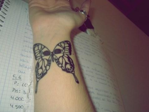 Skull Tip Butterfly Tattoo on Wrist