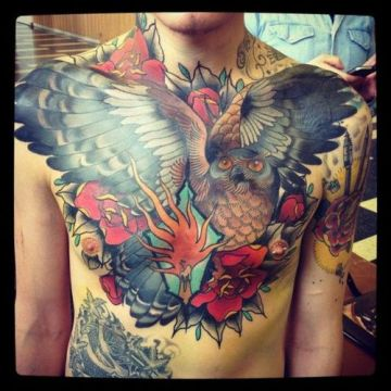 colored owl tattoo on man's chest