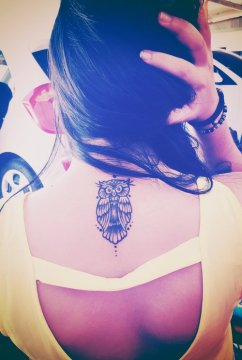 cute grump owl tattoo on upperback