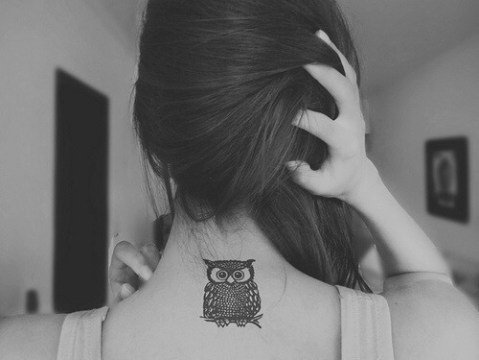 cute owl tattoo on upperback