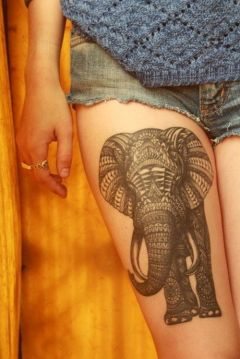 elephant tattoo on thigh