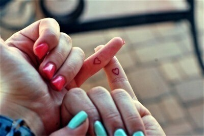 match heart on pinky finger tattoo