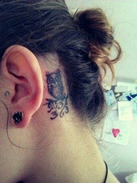 owl tattoo behind ear