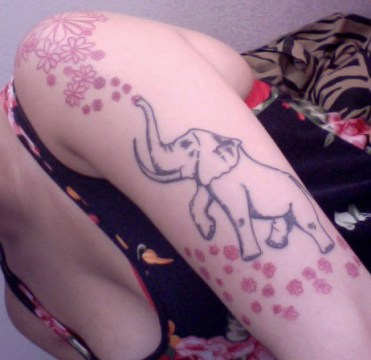 small daisy flowers and up trunk elephant tattoo