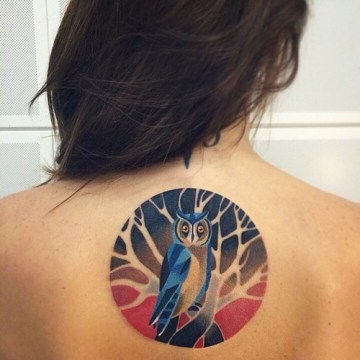 watercolor owl tattoo on back