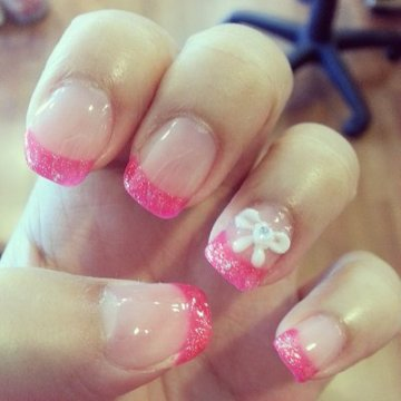 Hot Pink French Tip Nails With A Cute Bow And Diamond Accessory