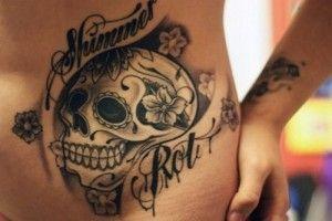 sugar skull with sentence tattoo