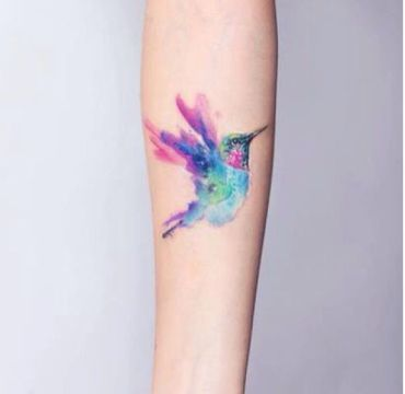 pastel hummingbird tattoo
