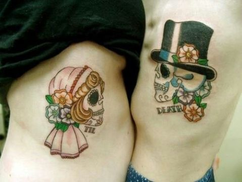 colorful skulls couple tattoo
