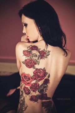 colorful back skull tattoo with flowers
