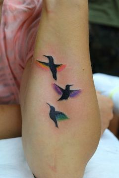 3 small hummingbirds tattoo