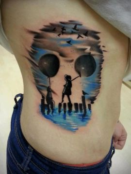 blue skull with balloons tattoo