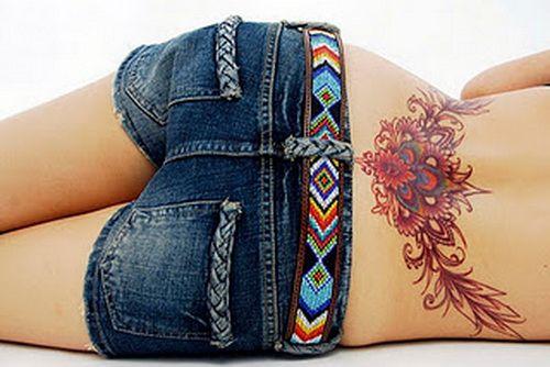 hawaiian flower tattoo lower back