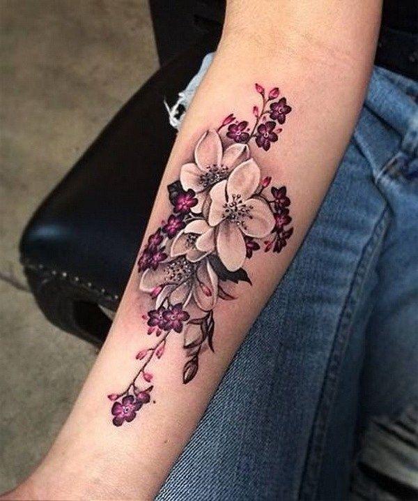 hawaiian flower tattoo on forearm