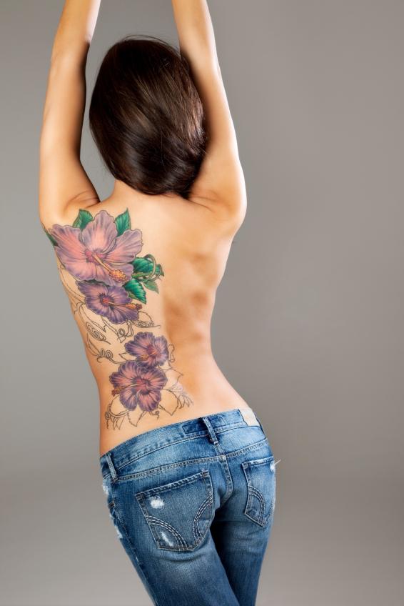 hawaiian flower tattoo on full back