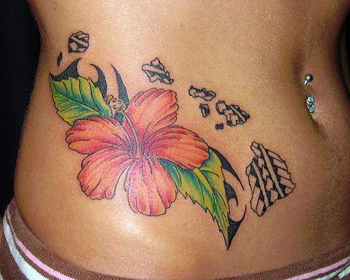 hawaiian flower tattoo on hip