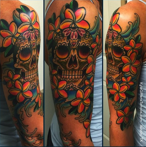hawaiian flower with skull tattoo arm