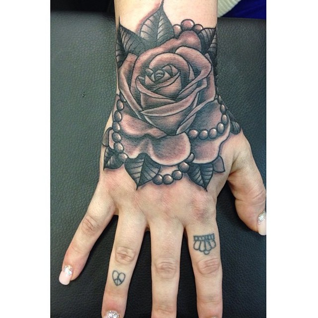 rose with pearl tattoo